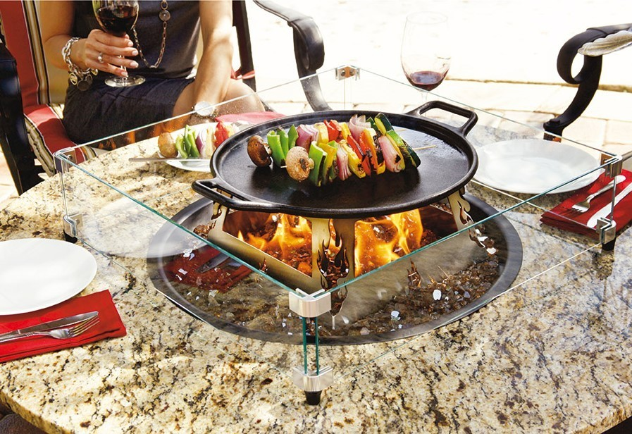 dining outdoors cooking fire table